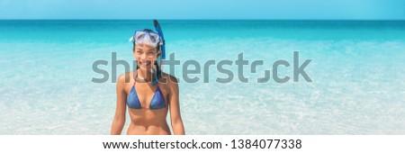 Snorkel swim beach summer holidays girl swimming in Caribbean idyllic paradise ocean water banner panorama. Smiling Asian woman having fun. Watersport lifestyle. #1384077338