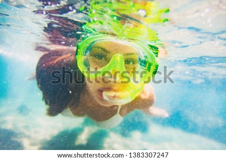 Snorkel water sport activity young Asian woman swimming underwater with snorkeling mask on Caribbean travel vacation having fun. Beach watersport active lifestyle. #1383307247