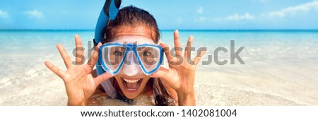 Snorkel watersport girl fun - Happy Asian tourist woman screaming of joy enjoying swimming with scuba mask on summer Caribbean travel vacation holidays banner panorama. #1402081004