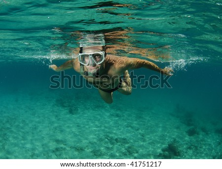 snorkeler in tropical sea