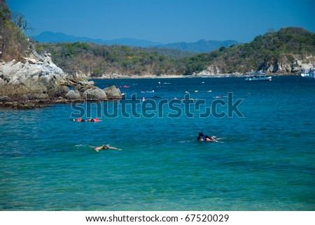 Snorkeling at the beach in Huatulco, Oaxaca, Mexico