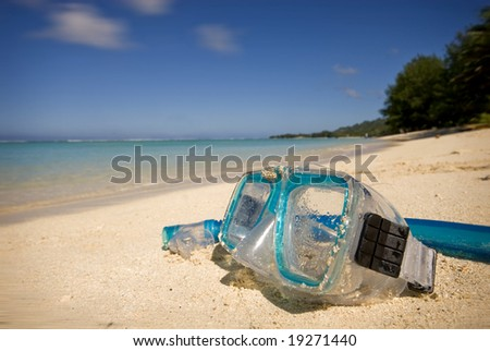 Snorkeling gear on white sand beach in Rarotonga, Cook Islands