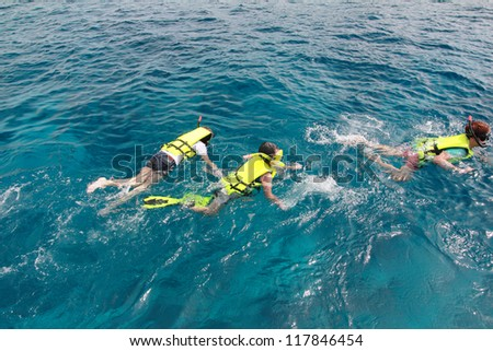 snorkeling in clean water over coral reef, in Similan Island Phangnga South of Thailand - stock photo