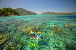 Snorkeling point with beautiful coralscape at Surin national park ,khao lak,Phang-nga, Thailand (Unkown People)