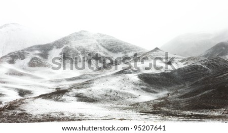 Snow and fog in the mountains of northern Mongolia