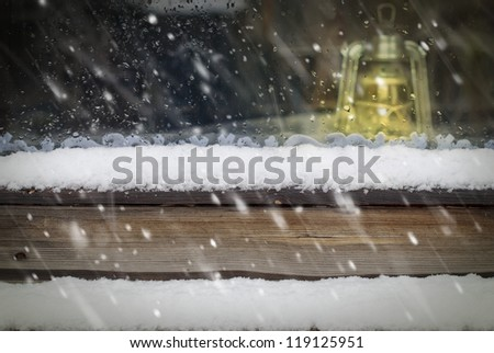 Snow at the Wooden Window
