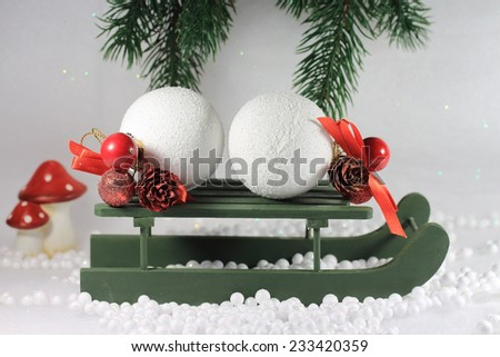 Snow balls on a wooden sleigh, in the snow.