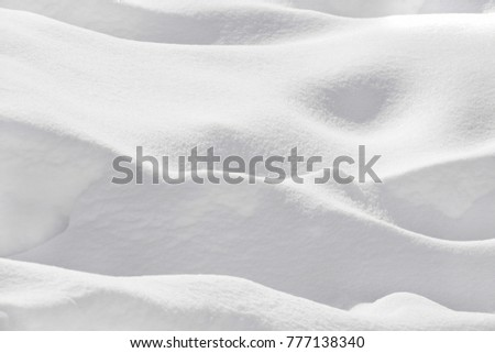 Snow banks, all white, monochromatic. Horizontal shoot, outdoor picture. Background. Snow texture. Only white.