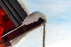 snow,barn and icicles in the winter park
