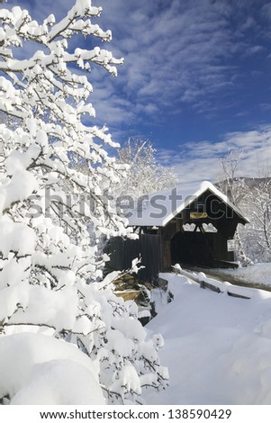 Snow blanketed Emily's covered bridge in Stowe Vermont, USA