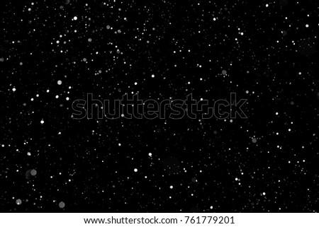 Snow blizzard on a black background