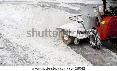 snow blowing machine in the street #95428042