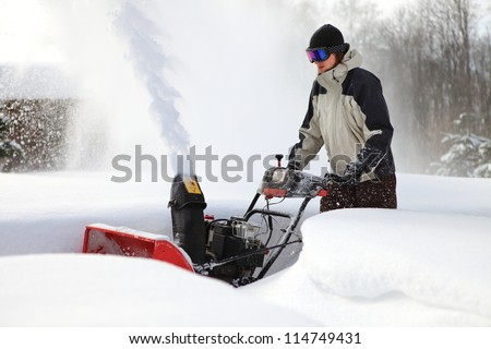 snow blowing man