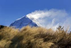 snow blowing over the top of Mount Cook at Mount Cook National Park, Canterbury, New Zealand