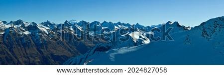Snow-capped mountain peaks of the Caucasus Mountain Range. Northern snowy mountains of the Caucasus.