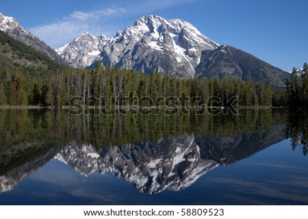 Snow capped mountain reflected in a crystal clear lake