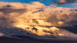 Snow-capped mountains in the Nyainqentanglha mountain range, Damxung County, Tibet, China