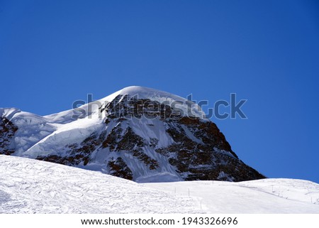 Snow capped mountains, snowfields and glaciers at Zermatt, Switzerland, seen from Gornergrat railway station. Photo taken March 23rd, 2021. Stock photo ©