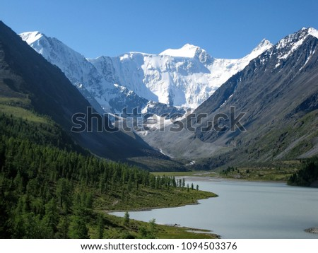 Snow-capped peaks and mountain lake of the Sikhote-Alin Range. Sikhote Alin, a mountainous country in the Far East, in Khabarovsk and Primorye. #1094503376