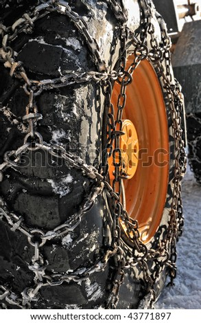 Snow chains on a big wheel