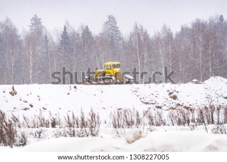 Snow clearing. Tractor clears the way after heavy snowfall