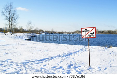 snow-covered beach and sign \