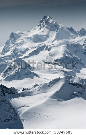 Snow covered beautiful mountain peaks #53949583