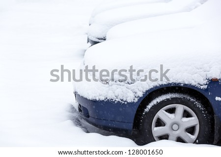 Snow covered cars after winter blizzard