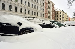 Snow covered cars parking on a street in Leipzig, Germany
