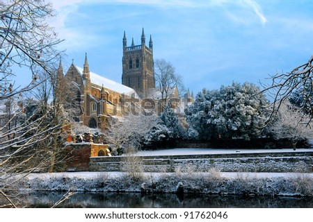 Snow covered Cathedral beside a river