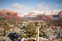 Snow covered coin-operated viewer at Sedona Airport viewpoint