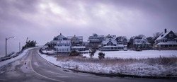 Snow Covered Houses on the Hill by the Coastal Road on Cape Cod