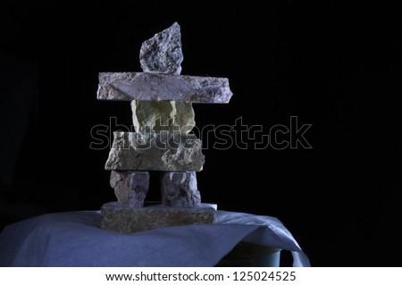 snow covered inukshuk in cold winter scene