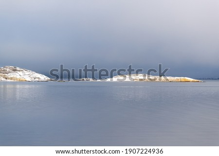 Snow covered island on Swedish west coast with no buildings or people Photo stock ©