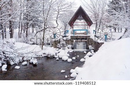 Snow-covered landscape in the city park