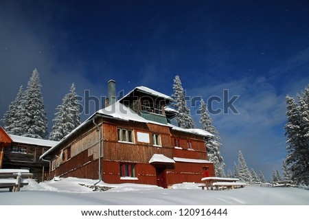 Snow covered mountain holiday house at winter