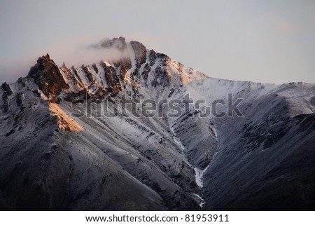 Snow covered mountain peak from Brooks Mountain Range in Northern Alaska