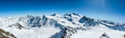Snow covered mountain peak winter panorama landscape