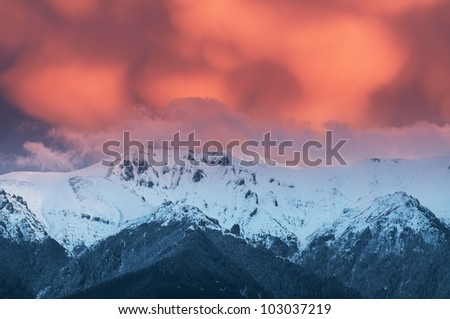 Snow covered mountains and dramatic cloudscape