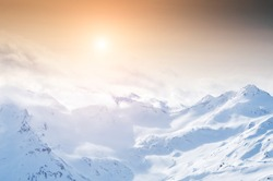 Snow-covered mountains at sunset. Beautiful winter landscape.