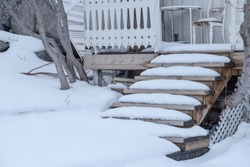 Snow covered on wooden stairs house in winter
