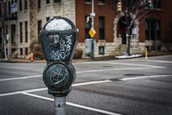 Snow covered parking meter in Charles North, Baltimore, Maryland.