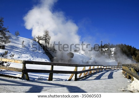 Snow covered path leading up to Mammoth Hot Springs at Yellowstone National Park