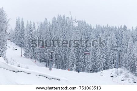 Snow covered pine tree forest and ski slope and lift. Mountain Jahorina, near the Sarajevo city. Bosnia and Herzegovina