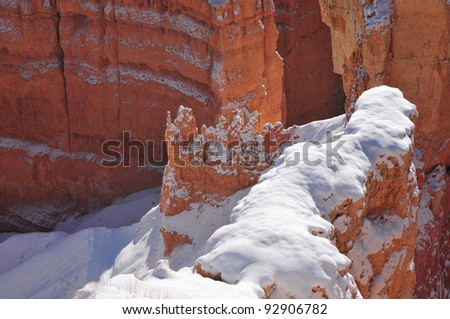 Snow covered plateau deep inside Bryce Canyon with colorful red rocks during early season snowstorm