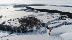Snow-Covered Ravines. Winter landscape. Aerial View. Quadrotor Filming