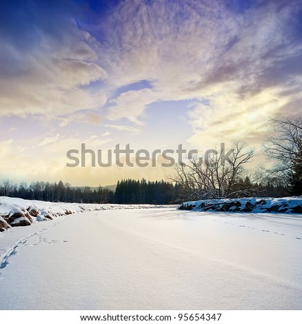 snow covered river and beautiful sunset