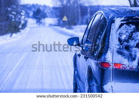 Snow-covered road in winter, car on a dangerous stretch of road covered with snow and ice.  #231500542