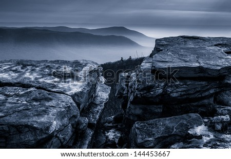 Snow covered rocks and a foggy winter view from Tower Road on Tuscarora Mountain near McConnellsburg, Pennsylvania
