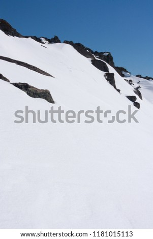 Snow covered rocks in Perisher Snow Resort in New South Wales in Australia in winter